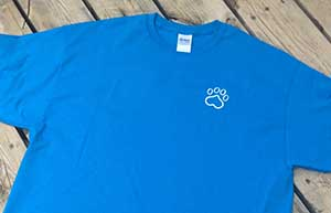 Sit Happens blue t-shirt front